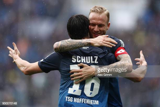 Nico Schulz of Hoffenheim celebrates with Kevin Vogt of Hoffenheim after he scored a goal to make it 10 during the Bundesliga match between TSG 1899...