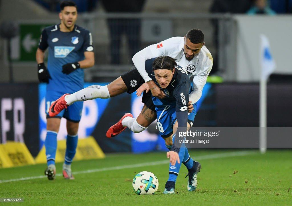 Nico Schulz of Hoffenheim is challenged by Kevin-Prince Boateng of Frankfurt during the Bundesliga match between TSG 1899 Hoffenheim and Eintracht Frankfurt at Wirsol Rhein-Neckar-Arena on November 18, 2017 in Sinsheim, Germany.
