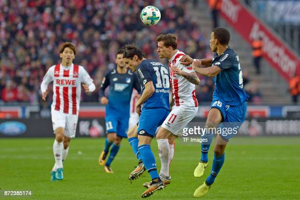 Nico Schulz of Hoffenheim Simon Zoller of FC Koeln and Kevin Akpoguma of Hoffenheim battle for the ball during the Bundesliga match between 1 FC...