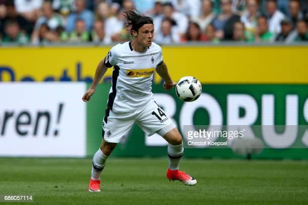 Nico Schulz of Moenchengladbach runs with the ball during the Bundesliga match between Borussia Moenchengladbach and SV Darmstadt 98 at BorussiaPark...