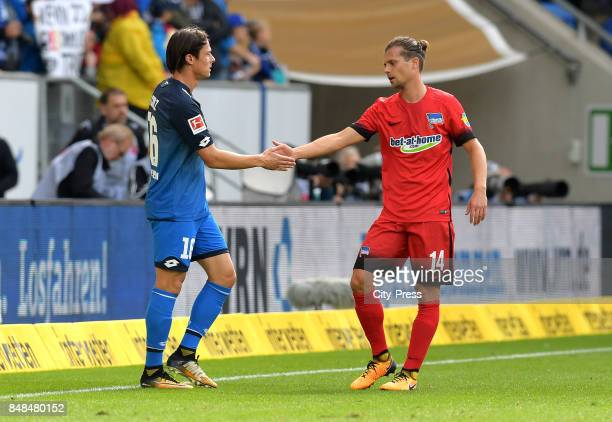 Nico Schulz of the TSG 1899 Hoffenheim and Valentin Stocker of Hertha BSC after the game between TSG Hoffenheim and Hertha BSC on september 17 2017...