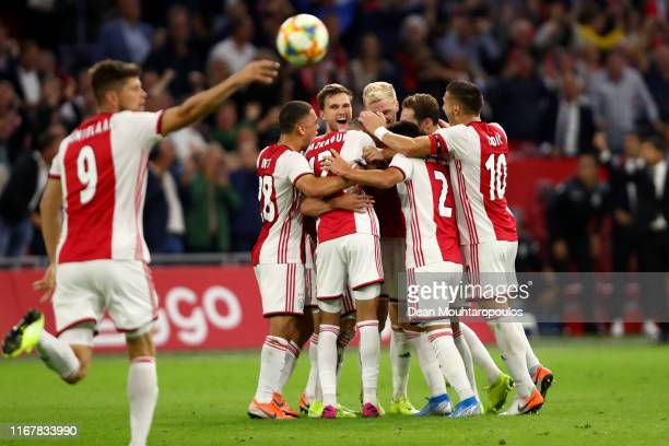 Nico Tagliafico of Ajax celebrates with his teammates after scoring his sides second goal during the UEFA Champions League Third Qualifying Round...