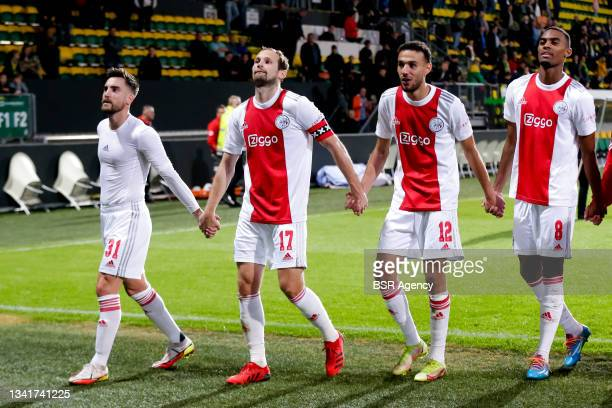 Nico Tagliafico of Ajax, Daley Blind of Ajax, Noussair Mazraoui of Ajax and Ryan Gravenberch of Ajax celebrate theirs sides win during the Dutch...