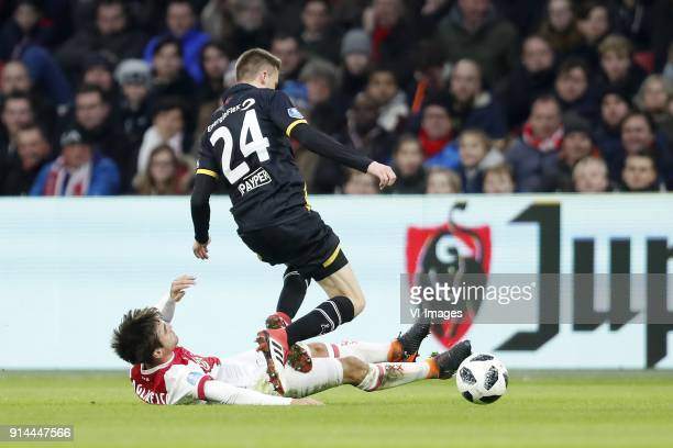 Nico Tagliafico of Ajax Lucas Schoofs of NAC Breda during the Dutch Eredivisie match between Ajax Amsterdam and NAC Breda at the Amsterdam Arena on...