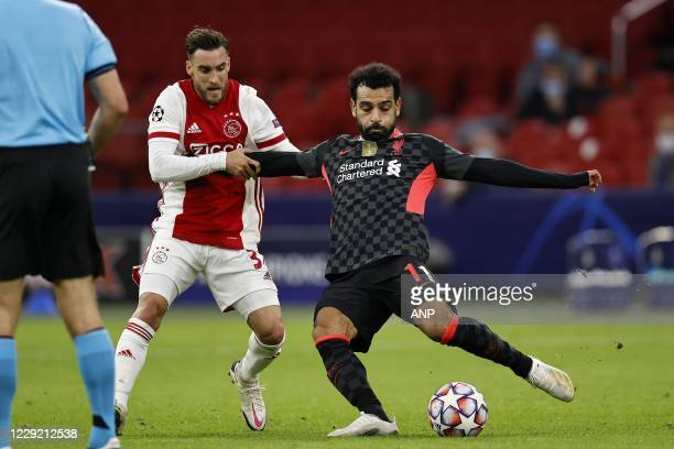 AMSTERDAM Nico Tagliafico of Ajax Mo Salah or Liverpool FC during the UEFA Champions League match in group D between Ajax Amsterdam and Liverpool FC...