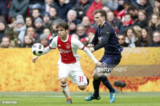 Nico Tagliafico of Ajax Peet Bijen of FC Twente during the Dutch Eredivisie match between Ajax Amsterdam and FC Twente Enschede at the Amsterdam...