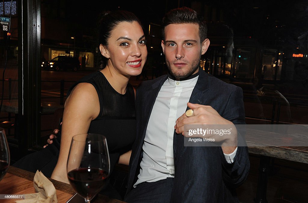 Nico Tortorella (R) and guest attend the premiere after party of A24's 'Under The Skin' at Umami Burger on March 25, 2014 in Los Angeles, California.