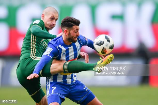 Nico Varela of Wisla Plock holds off pressure from Piotr Celeban of Slask Wroclaw during Lotto Ekstraklasa match between Slask Wroclaw and Wisla...