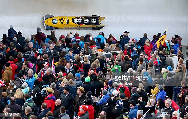Nico Walther, Andreas Bredau, Marko Huebenbecker and Christian Poser of Germany compete in their first run of the four man bob competition during the...