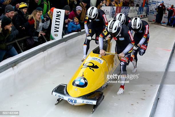 Nico Walther, Marko Huebenbecker, Christian Poser and Philipp Wobeto of Germany compete in their first run of the four men's bob competition during...