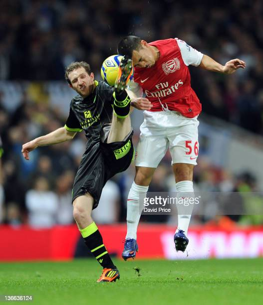 Nico Yennaris of Arsenal challenges Mika Vayrynen of Leeds during the FA Cup Third Round match between Arsenal and Leeds United at Emirates Stadium...