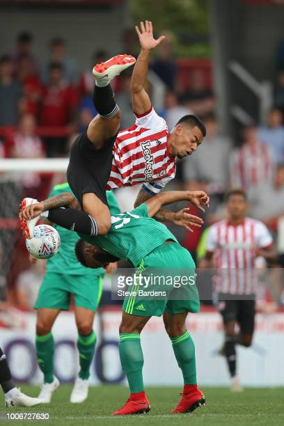 Nico Yennaris of Brentford is upended by the challenge of Alex Jakubiak of Watford during the preseason match between Brentford and Watford at...