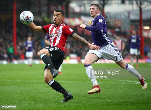 Nico Yennaris of Brentford shoots at goal as John Lundstram of Sheffield United follows behind during the Sky Bet Championship match between...