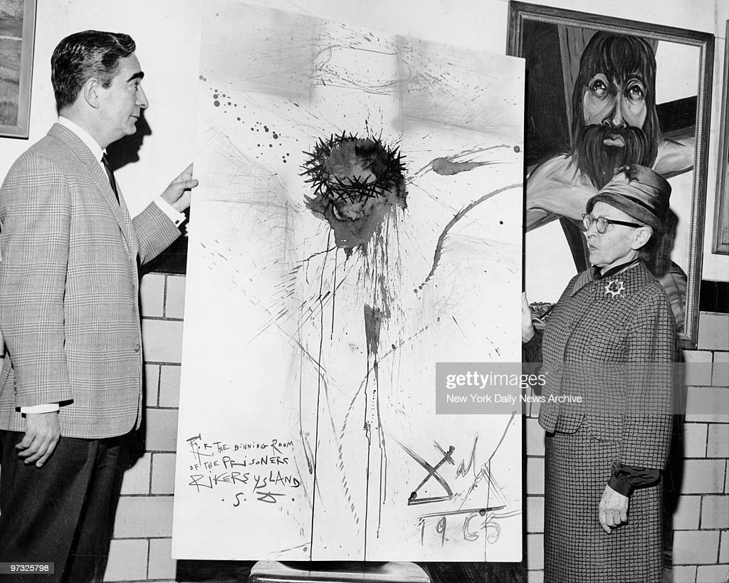 Nico Yperifanos, Salvador Dali's personal representative, presents artist's 'Christ on the Cross' to Rikers Island prison. Correction Commissiojner Anna Kross accepts the work.