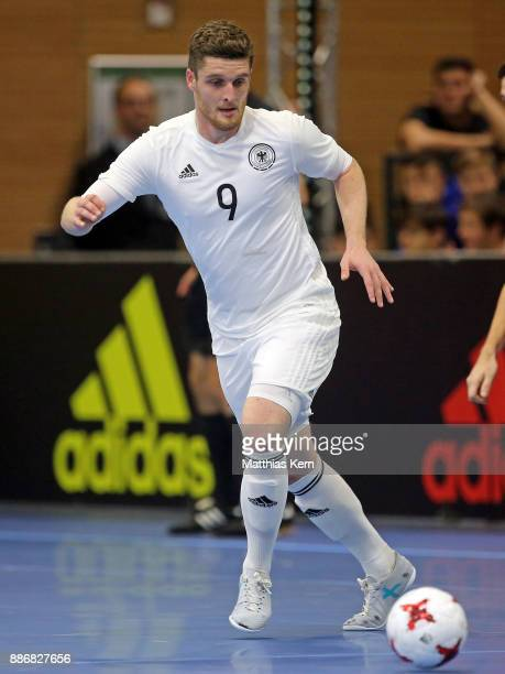 Nico Zankl of Germany runs with the ball during the Futsal international friendly match between Germany and Czech Republic at Ballsport Arena on...