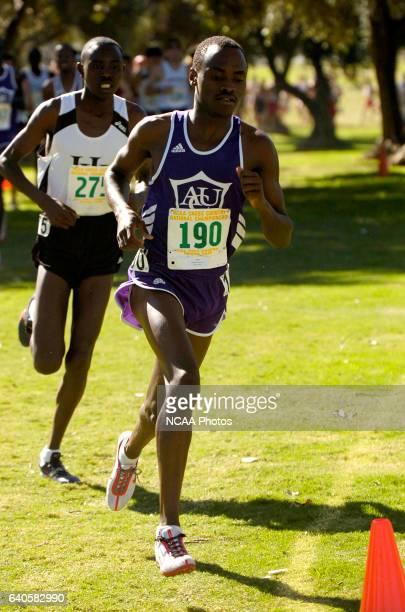 Nicodemus Naimadu of Abilene Christian University and James Cheruiyot of Harding race toward the finish line during the Division II Men's and Women's...