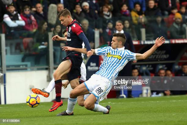 Nicolò Barella of Cagliari and Alberto Grassi of Spal in contrast during the serie A match between Cagliari Calcio and Spal at Stadio Sant'Elia on...