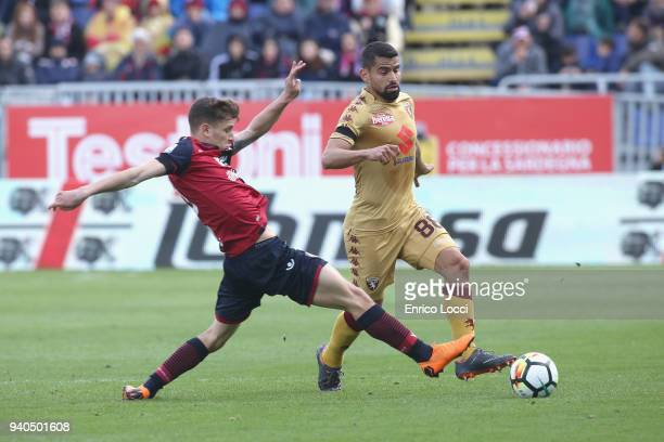 Nicolò Barella of Cagliari battle for the ball during the serie A match between Cagliari Calcio and Torino FC at Stadio Sant'Elia on March 31 2018 in...