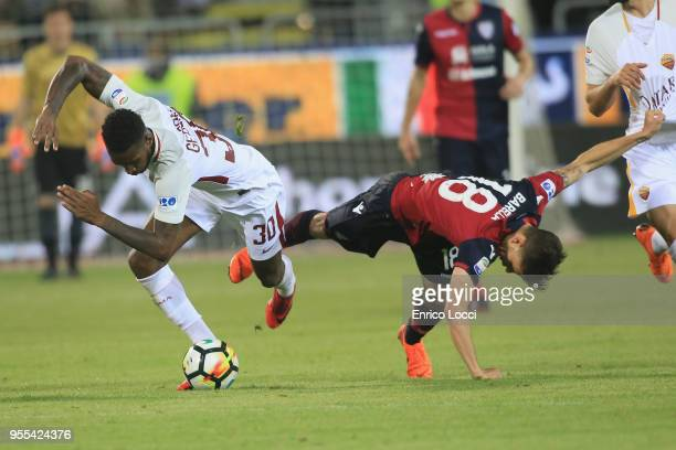 Nicolò Barella of Cagliari in contrast swith Gerson of Roma during the serie A match between Cagliari Calcio and AS Roma at Stadio Sant'Elia on May 6...