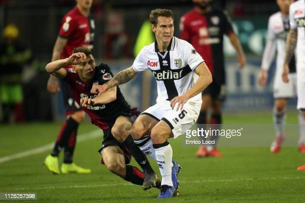 Nicolò Barella of Cagliari in contrast with Leo Stulac of Parma during the Serie A match between Cagliari and Parma Calcio at Sardegna Arena on...