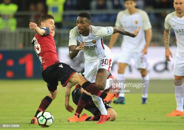 Nicolò Barella of Cagliari vies with Gerson of Roma during the serie A match between Cagliari Calcio and AS Roma at Stadio Sant'Elia on May 6 2018 in...