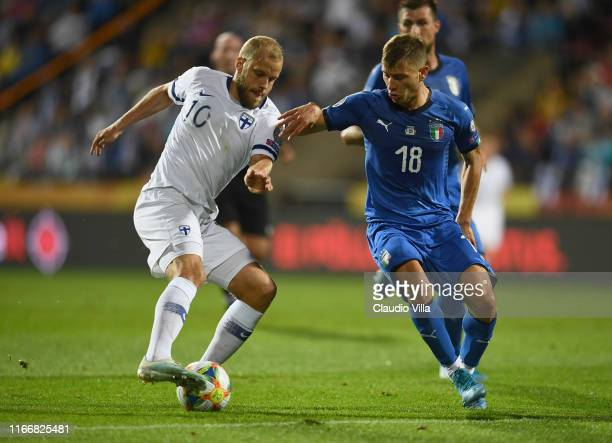 Nicolò Barella of Italy competes for the ball with Pukki of Finland during the UEFA Euro 2020 qualifier between Italy and Finland at Tampere stadium...