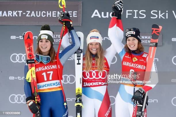 Nicol Delago of Italy takes 2nd place Corinne Suter of Switzerland takes 1st place Michelle Gisin of Switzerland takes 3rd place during the Audi FIS...