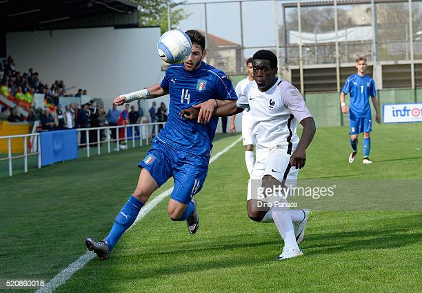 Nicol Tofanari of Italy competes with Chris Maoussa of France during the U18 international friendly match between Italy and France at Stadio Appiani...
