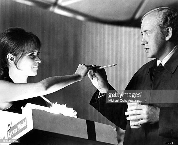 Nicol Williamson and Anna Karina touch hands in a scene from the film 'Laughter in the Dark' 1969