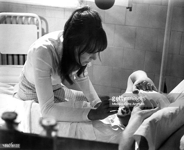 Nicol Williamson in bed with a injury with Anna Karina at his bedside concerned in a scene from the film 'Laughter in the Dark' 1969