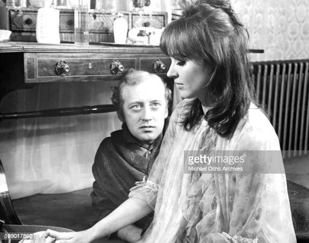 Nicol Williamson looking up at Anna Karina in a scene from the film 'Laughter in the Dark' 1969