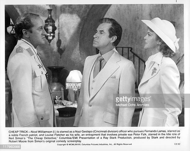 Nicol Williamson talks with Fernando Lamas and Louise Fletcher in a scene from the film 'The Cheap Detective' 1978