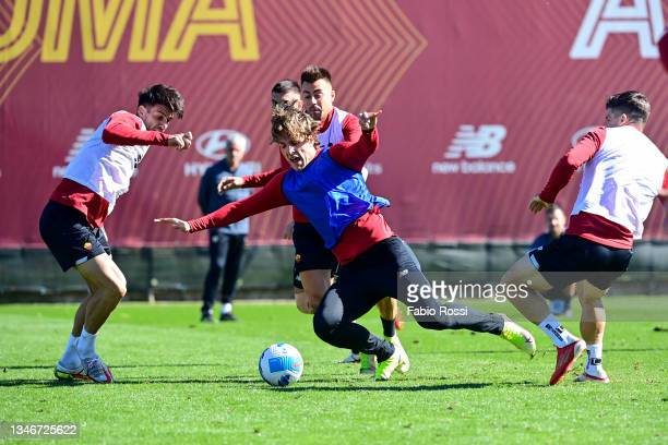 Nicolò Zaniolo is challenged by Roger Ibanez during a training session at Centro Sportivo Fulvio Bernardini on October 15, 2021 in Rome, Italy.