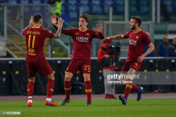 Nicolà Zaniolo of AS Roma celebrates with his teammates Aleksandar Kolarov and Bryan Cristante after scoring a goal during the Serie A match between...