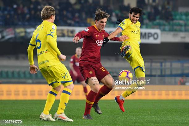 Nicolò Zaniolo of AS Roma competes for the ball with Medhi Leris of Chievo Verona during the Serie A match between Chievo Verona and AS Roma at...