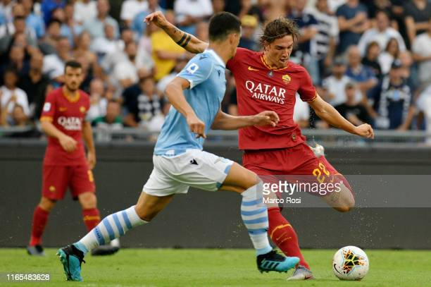 Nicol˜ Zaniolo of AS Roma kicks the ball against Luiz Felipe Ramos Marchi of SS Lazio during the Serie A match between SS Lazio and AS Roma at Stadio...