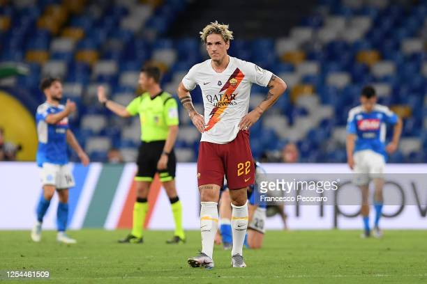 Nicolò Zaniolo of AS Roma stands disappointed after the Serie A match between SSC Napoli and AS Roma at Stadio San Paolo on July 05, 2020 in Naples,...