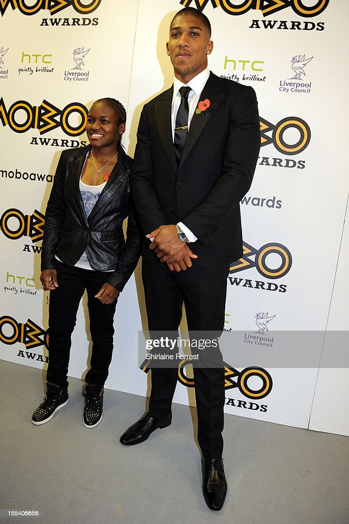 Nicola Adams and Anthony Joshua pose in the awards room at the 2012 MOBO awards at Echo Arena on November 3, 2012 in Liverpool, England.