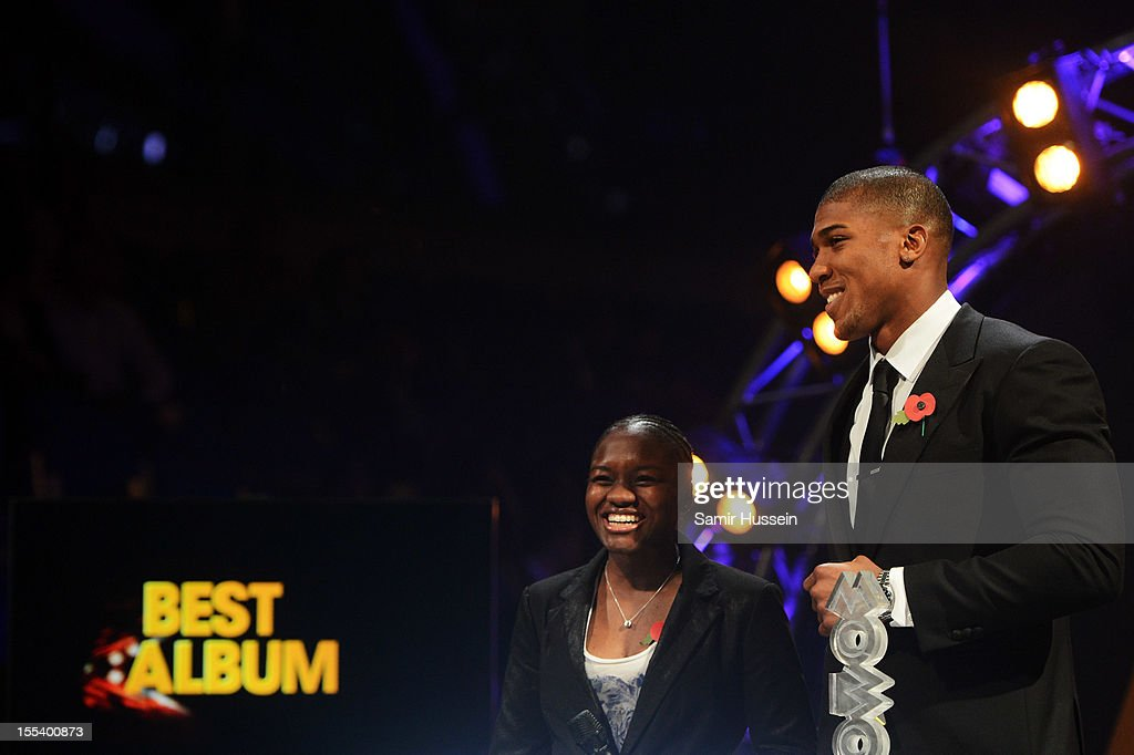 Nicola Adams and Anthony Joshua present the Best Album award at the 2012 MOBO awards at Echo Arena on November 3, 2012 in Liverpool, England.