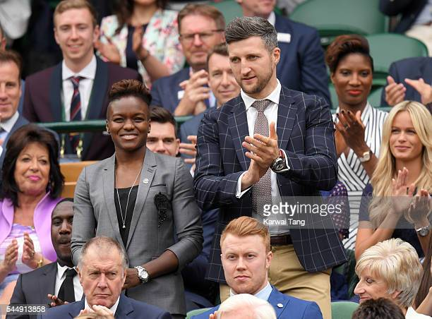 Nicola Adams and Carl Froch attend day six of the Wimbledon Tennis Championships at Wimbledon on July 02 2016 in London England