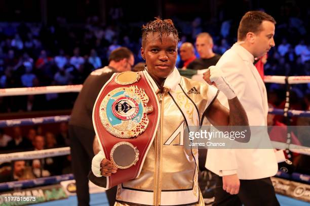 Nicola Adams celebrartes retaining her belt after a split decision draw in the WBO World Flyweight Championship Title fight between Nicola Adams and...
