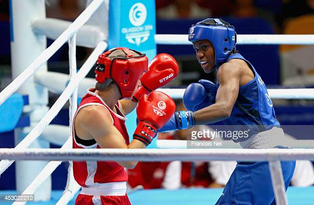 Nicola Adams of England competes against Mandy Bujold of Canada during the Women's Fly 4851 kg SemiFinals Boxing at Scottish Exhibition And...