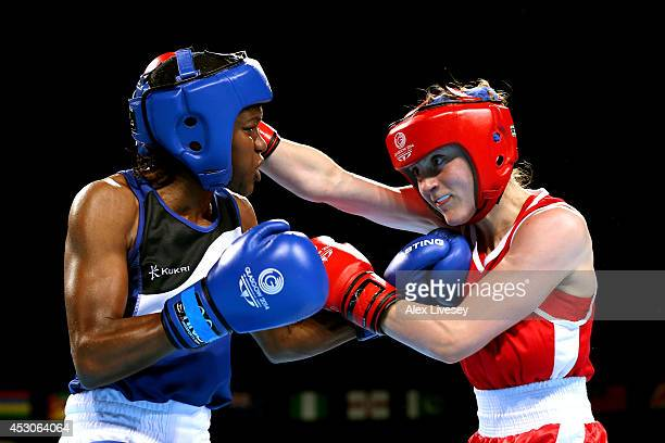 Nicola Adams of England competes with Michaela Walsh of Northern Ireland in the Women's Fly Final at SSE Hydro during day ten of the Glasgow 2014...
