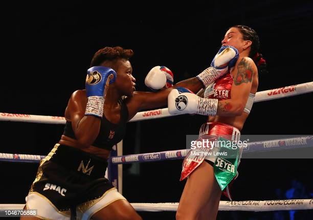 Nicola Adams of England in action against Isabel Millan of Mexico during the Interim WBO World Female Flyweight Championship contest at Morningside...