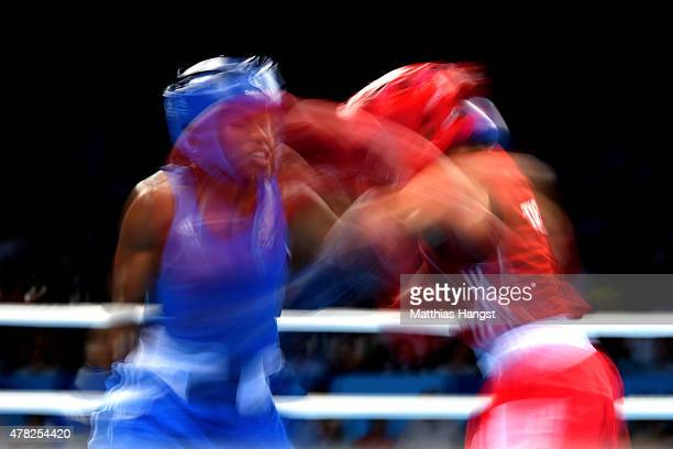 Nicola Adams of Great Britain and Elif Coskun of Turkey compete in the Women's Boxing Flyweight Semi Final during day twelve of the Baku 2015...
