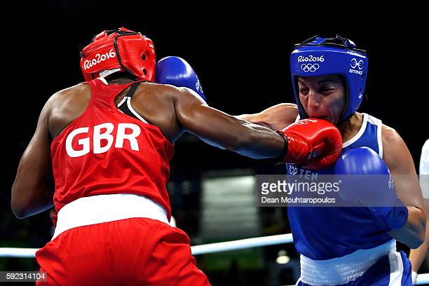 Nicola Adams of Great Britain and Sarah Ourahmoune of France in action during the Women's Fly Final Bout on Day 15 of the Rio 2016 Olympic Games at...
