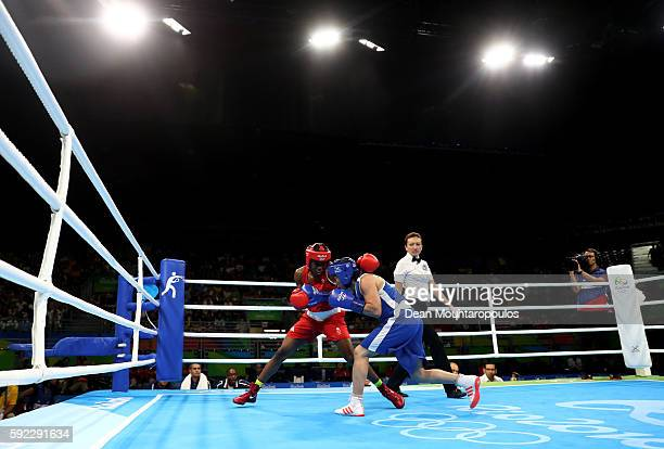 Nicola Adams of Great Britain and Sarah Ourahmoune of France slug it out during the Women's Fly Final Bout on Day 15 of the Rio 2016 Olympic Games at...