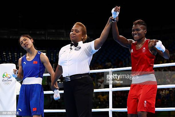 Nicola Adams of Great Britain celebrates after defeating Cancan Ren of China during a Women's Fly Semifinal bout on Day 13 of the 2016 Rio Olympic...