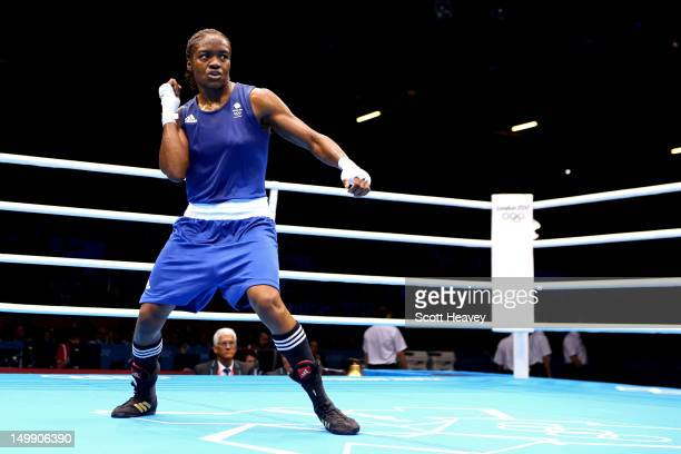 Nicola Adams of Great Britain celebrates after defeating Stoyka Petrova of Bulgaria during the Women's Fly Boxing Quarterfinals on Day 10 of the...