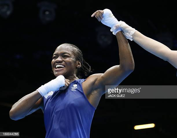 Nicola Adams of Great Britain celebrates her gold medal victory over Cancan Ren of China in the women's boxing Flyweight final of the 2012 London...